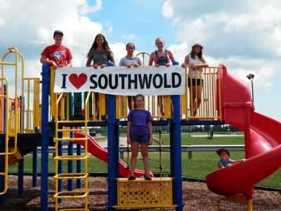 Children on playground with I Love Southwold Sign